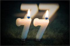 seventy seven (mikeyp2000) Tags: candles seventyseven flame seven bokeh candle