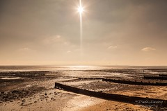 Sunset at the Garrison (Dave Denby) Tags: eastbeach southendonsea beach cloud essex flare holiday landscape sand sea seaside sky sun tide tourism travel vacation
