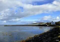 Wideford Hill Beyond The Finstown Pier (orquil) Tags: finstown village long pier nice houses seaside stony shoreline calm sea bayoffirth distant wideford hill sunny october afternoon autumn sunshine blue sky cloudscape westmainland orkney islands scotland uk unitedkingdom greatbritain orcades attractive view colourful scenic seascape