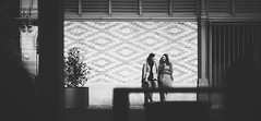 Discussing... (elgunto) Tags: people street streetphoto mercat elborn barcelona blackwhite bw sonya7 canonfd135 manuallense