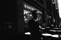 Street scenes (Helsinki Drifter) Tags: streetphotography urban scene dark obscure man smoking eyecontact interaction socialdocumentary helsinki finland filmphotography contrast pushprocess selfdeveloped ei6400 extremepush tmax400 candid capture blackandwhite