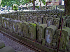 Buddhist temple in Yanaka (Tokyo) (isobrown) Tags: numerous sculptures bouddha buddha stone lines yanaka tokyo underthetrees moss mousse nobody canong10 canon japan japon japanese japonais lignes urbain urban