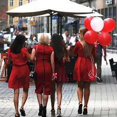 Red fiesta (mkorolkov) Tags: street streetphotography red dress ladies women baloons candid walk walking pavement fujifilm xe1 xc50230