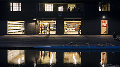 Dawn at the boatsheds. (Tris1972 (tmorphewimages.co.uk)) Tags: boat boatshed cambridge cambridgeshire cam river rivercam morning dawn early people building architecture lights reflections sport university universityofcambridge uk england eastanglia water outdoor training