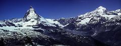 The Matterhorn and Adjacent Peaks From Gornergrat (woodchuckiam) Tags: mattterhorn gornergrat mountains peaks snow cliffs rock sky scenic landscape woodchuckiam
