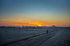Dutch december morning (Civilis Brutus) Tags: sunrise zonsopkomst frost vorst rijp hoar weiland meadow uiterwaarden foreland dijk dike diepenveen landschap landscape farm boerderij cyclist fietser fietspad nikon p7800 winter