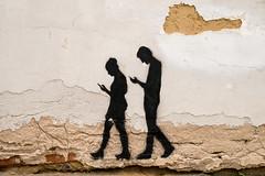 Walking in Prague (romanboed) Tags: graffiti leica m 240 summilux 50 prague praha praag prag praga bohemia cesko czech republic wall spray paint walking mobile addiction antisocial couple art