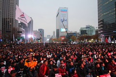"""Seoul Korea Kwanghwamun candle rally November 19th calling for outster of President - """"What Half a Million Gets You in Seoul"""" (moreska) Tags: seoul korea kwanghwamun rally protest demonstration november 19th democracy freespeech politicalparties huge massive crowds  red sunset lateafternoon highiso buildings structures ilbo offices flags currentevents rok asia"""