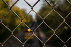 UP through the fench (andrew_busse) Tags: andrew busse photography union pacific railroad train photo east bound coal hopper ames iowa midwest fall season bokeh fench chain link