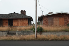 Twins (sidelinesjr) Tags: houses abandoned oregon newport