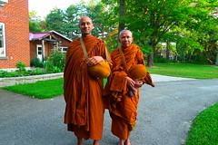 Vens. Suvijjano (R) and Atulo (L) prepare to leave for pindapat