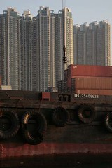 HK_cargoBoat_110 (urban-decoy) Tags: sunset sea sky water port hongkong boat industrial dusk cargo shipping kowloon containers logistics
