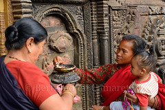 Akash Bhairav temple, Bhaktapur (Bertrand de Camaret) Tags: voyage door travel nepal red woman art lamp horizontal architecture rouge temple fire lampe asia child femme religion ngc porte asie tradition enfant puja feu nationalgeographic lampeahuile bhairav 2013 akashbhairav bertranddecamaret