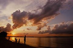 Cool Off (Explored) (OzGFK) Tags: ocean sunset sea sky cloud sun film beach water silhouette clouds analog evening singapore asia fuji slide velvia pasirris nikkor nikonfm3a