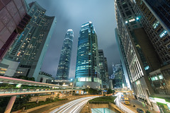 Hong Kong Central IFC  (KL.Lau  ) Tags: street city longexposure sky motion tree vertical skyline architecture modern night speed skyscraper outdoors photography hongkong streetlight cityscape sony ngc citylife tranquility nopeople landmark illuminated business transportation  financial ifc development a7 afterdark crowded citystreet lighttrail chineseculture 14mm traveldestinations colorimage buildingexterior samyang 2013 lowangleview  hongkonginternationalfinancecentre