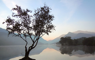 Padarn misty sunrise reflection.