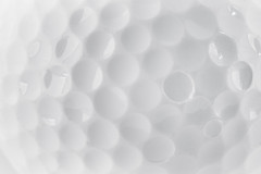 CLose up of a Golf Ball texture (anekphoto) Tags: shadow white game color detail macro reflection texture sport closeup ball golf circle one soft long pattern close shot bright image path background object professional sphere single golfing round backdrop gloss leisure isolated golfball foreground