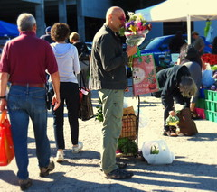 Taking time to smell his flowers (Renee Rendler-Kaplan) Tags: people male guy sunshine canon shopping him tents shadows gbrearview market shoppingcart dude september there suburb bouquet jackets stalls gapersblock delightful stopped wbez saturdays 2014 purchases shoppingbags chicagoist caughtmyeye peoplewalking evanstonfarmersmarket peoplestanding orisit evanstonillinois cooltemps reneerendlerkaplan canonpowershotsx40hs notbillycorgan peoplebendingdown