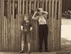 090914_6_edit (plw1053) Tags: street family boy blackandwhite bw woman monochrome sepia looking grandmother candid tourist binoculars grandson toned canong15 powershotg15
