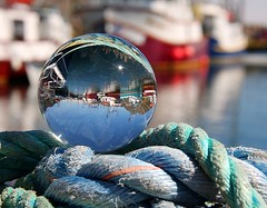 Upside Down World (Karen_Chappell) Tags: blue water glass newfoundland ball circle boats boat fishing harbour orb rope round refraction nfld fortamherst