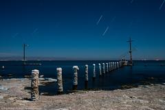 A Peerless View (dejavue.us) Tags: navy navypier nikon desert saltonsea pier water pilings shore california abandoned 180350mmf3545 startrails fullmoon longexposure nikkor nightphotography d800 vle