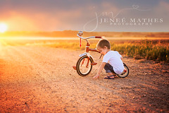 A Boy & His Tricycle (JeneeMathes) Tags: gavin toddler two 2 sunset country countryside countryroad backroad dirt play wonderful ambient childhood jenee mathes jeneemathes buhlerks hutchinsonks kansasportraitphotographer ksportrait nikon nikkor d800 85mm radioflyer