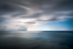 Ever Changing Sea - Long Exposure (byron bauer) Tags: byronbauer gray blue sea ocean water coast seascape timeexposure currents sky clouds dark distant rain storm hazy horizon painterly movement drifting
