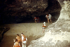 35-064 (ndpa / s. lundeen, archivist) Tags: nick dewolf nickdewolf color photographbynickdewolf 1970s 1973 1972 film 35mm 35 reel35 arizona northernarizona southwesternunitedstates canyon marblecanyon grandcanyon coloradoriver raftingtrip raftingexpedition rafting river riverrafting watersedge riversedge riverbanks beach sand people hikers hiking lifejackets lifepreservers floatationdevices children kids climbers climbing cave
