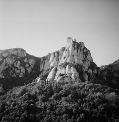 Montserrat view (.grux.) Tags: ilfordsporti film mediumformat ilfordxp2 120 6x6 zonefocus sky mountain peak testroll montserrat spain