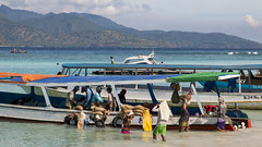 Busy Activity near the Delivery Boat (HansPermana) Tags: lombok indonesia gilitrawangan holiday trip travel relax happy people crowds delivery work teamwork boats mountain sea water bluesky blue seascape activity grocery