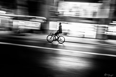 Behind the white line (Bruno Frerejean) Tags: movedphotos motionblur floucynétique streetphotos nightshot peopleintown loneliness longexposure blackwhite tokina1116mmf28 blancoynegro bicycle streetpeople floudemouvement soledad