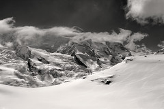 The Klein Matterhorn , the Breithorn under clouds . A view from the train to the Gornergrat. No. 4214 B&W. (Izakigur) Tags: valais wallis nikond700 nikkor nikkor2470f28 kantonwallis cantonduvalais zermatt glacier switzerland matterhorn klein gornergrat trainstation snow white blackwhite schweiz europe ice swiss suizo suisia svizzera view nikon d700 happynewyear2017 happynewyear suiza suïssa winter neige