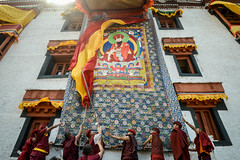 Monks display a giant Thangkha, a religious painting of their guru, on the wall of their monastery during a festival. (Leonid Plotkin) Tags: asia buddhism buddhist ceremony cham dance dancing festival hemis india ladakh religion religious rite ritual tradition traditional tsam tsechu