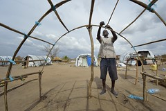 Man displaced by conflict in South Sudan builds shelter (Caritas Internationalis) Tags: africa camp house man home church water construction war southsudan african refugees sudan tent structure wash violence conflict shelter build nca displaced idps ssd juba salesians internallydisplaced actalliance