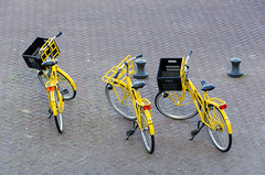 Three yellow bikes (Jan van der Wolf) Tags: bike bicycle yellow bikes bicycles repetition geel fiets herhaling map126105vv