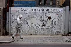 look (Ρanayotis) Tags: city london deleteme7 look walking saveme savedbythedeletemegroup saveme2 saveme10 graffitti juxtaposition coincidence passersby deleteme1