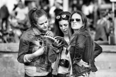 Tourists (d_t_vos) Tags: street camera girls portrait blackandwhite bw woman white black netherlands sunglasses amsterdam book women dof bokeh dam watching streetphotography teenagers tourist tourists chick jeans chicks streetview admiring searching youngwomen admire touristguide facesofportraits dickvos dtvos