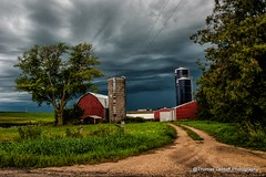 Approaching storm (Thomas DeHoff) Tags: red storm clouds sony barns iowa farmstead a700