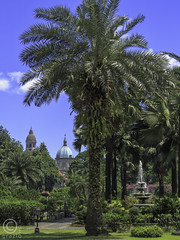 Tropical Cathedral Grounds (FotoGrazio) Tags: park blue hot tree green tourism church fountain architecture landscape islands asia