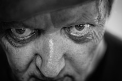 Don't make him angry (Giulio Magnifico) Tags: life boss man black detail macro eye look closeup composition contrast dark crazy eyes expression character fear bad citylife thoughtful streetphotography streetportrait sharp elder angry essence aged bonnet gaze glance glacial udine nikond800e nikkormicro105mmafsvrf28