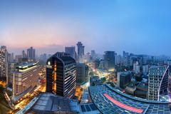 Centurions (Mabmy) Tags: city sunset panorama skyline canon buildings hotel haze singapore cityscape south sigma orchard 12mm panpacific suites hdr 1dx manualblending mandarinorchard