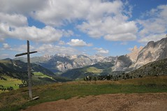 The cross (Vee living life to the full) Tags: italy leger travel touring holiday landscape rock pass sella towers mountain nikond300 heathaze view road sky cloud blue cross sassolungo