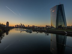A cold sunset by the riverside. (benjaminwolf1) Tags: silhouette water boat river riverside reflection skyscraper skyline sky cityscape illuminated glass sunset frankfurt