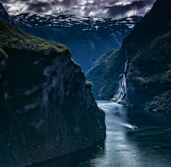 The seven sisters wearing their bridal veils. (wimvandemeerendonk, back in the cold brrrrr!) Tags: blue contrast clouds cloud falls green glacier heaven hill hills landscape light mountain mountainscape monumental minolta nature norway geirangerfjord geiranger outdoors outdoor ocean fjord panorama reflection rock rocks ripples sony sky tree trees telelens valley view wimvandem wild water waves wave waterfall waterfalls unescoworldheritage 150199faves rockpaper