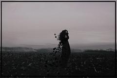 (emmakatka) Tags: wind woman portrait northdakota prairie fire smoke emmakatka blackandwhite dark eerie creepy hat ghost fog alone bokeh field hair