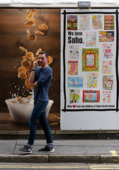 Cornflakes (stevedexteruk) Tags: soho cornflakes hoarding cereal london uk 2016 man mobile phone