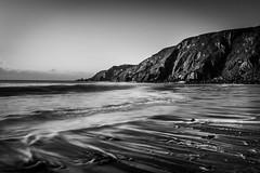In Darker Times (garethleethomas) Tags: blackandwhite bnw mono beach dark moody canon coast sand water waves surf seascape landscape wales uk pembrokeshire outdoor longexposure monochrome seaside