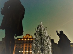 "Statue says "" Bah Humbug "" to Christmas Tree (hope2029) Tags: christmas tree statues silhouette low light leeds west yorkshire"