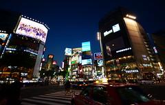 Scramble Crossing (iainwalker) Tags: red japan night advertising tokyo cyclist traffic taxi shibuya illumination billboard pedestrians shibuyacrossing pedestriancrossing tsutaya 2014 scramblecrossing inundate nikond7100