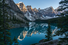 Moraine Lake sunset (NettyA) Tags: travel trees sunset lake canada mountains reflection nature water landscape alberta northamerica banffnationalpark morainelake canadianrockies 2014 valleyofthetenpeaks sonynex6